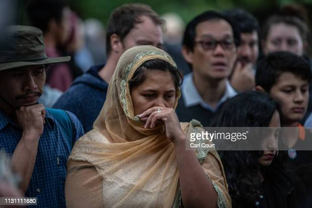 A woman looks on as people gather near Al Noor mosque on March 17 2019 in Christchurch New Zealand 50 people are confirmed dead with 36 injured still...