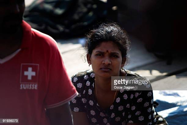 A woman looks on as Sri Lankan asylum seekers engage in a hunger strike after their boat broke down on the way to Australia's Christmas Island at...