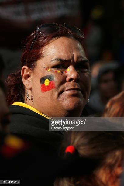 A woman looks on as thousands of people take part in the NAIDOC march on July 6 2018 in Melbourne Australia The march marks the start of NAIDOC Week...