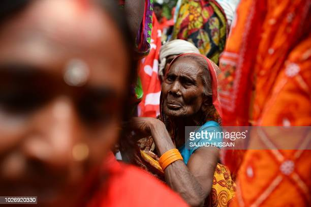 TOPSHOT A woman looks on at a protest rally called by the Centre of Indian Trade Unions affiliated with the Communist Party of India Marxist in New...