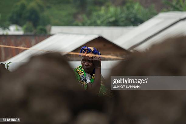 A woman looks on at the Mungote Internally Displaced Persons camp in Kitchanga 80 kilometres from Goma on February 23 2016 UN chief Ban Kimoon...