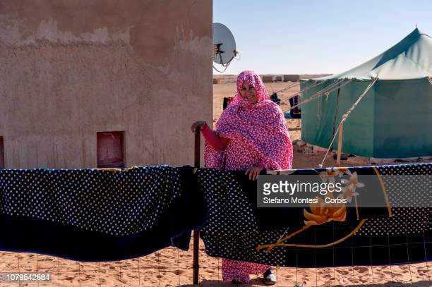 A woman looks on at the Saharawi refugee camp Asuerd on January 9 2019 in Tindouf Algeria