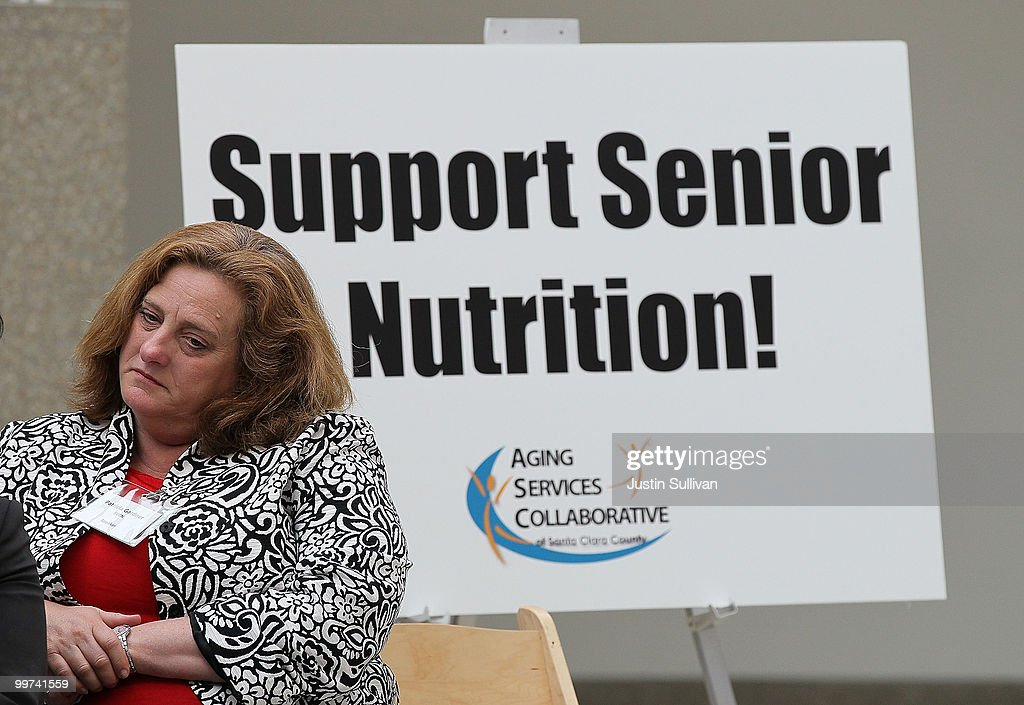 A woman looks on during a rally against budget cuts to senior programs at San Jose city hall May 17, 2010 in San Jose, California. Dozens of seniors attended a rally to oppose budget cuts to senior programs which include closing two popular senior centers that offer free meals.