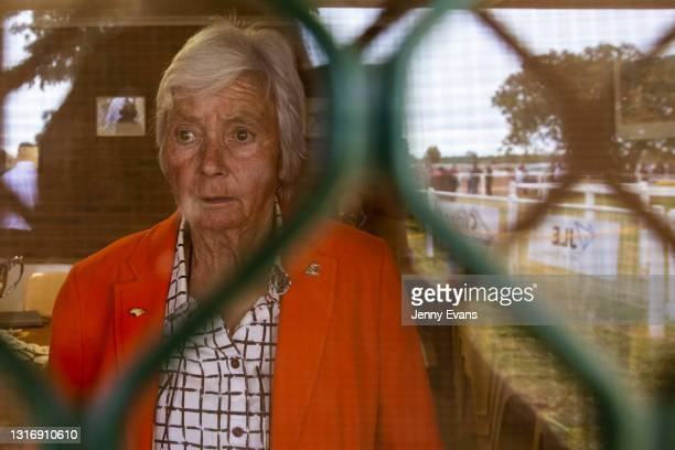 Woman looks on during the Cobar Races at Cobar Miners' Race Club on May 08, 2021 in Cobar, Australia. The race meet is held annually attended by...