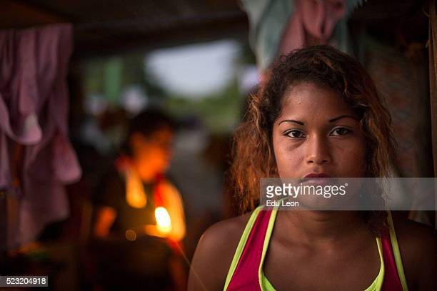 A woman looks on in the afternoon after an earthquake struck Ecuador on April 21 2016 in Pedernales Ecuador At least 400 people were killed after a...