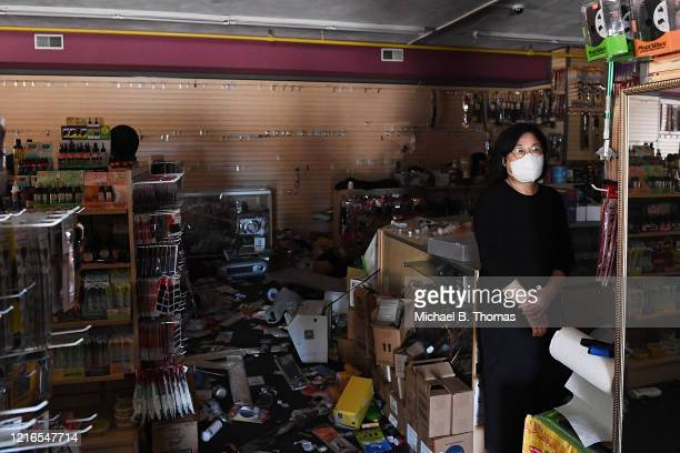 A woman looks on inside a looted Beauty World supply store on May 31 2020 in Ferguson Missouri Major cities nationwide saw demonstrations over the...