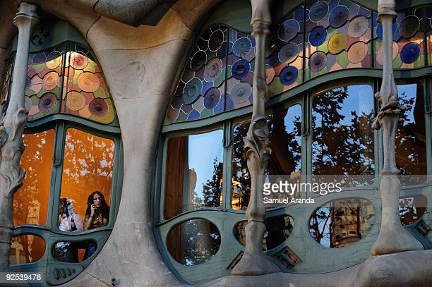 A woman looks out by a window in Casa Batllo building on October 30 2009 in Barcelona Spain Casa Batllo is a building restored by Antoni Gaudi built...