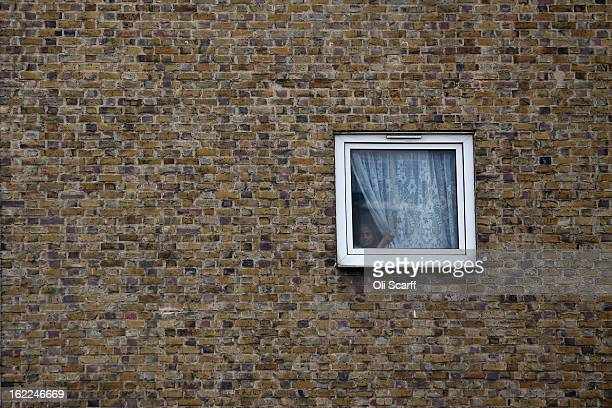 A woman looks out from a residential development in the London borough of Tower Hamlets on February 21 2013 in London England A recent study has...