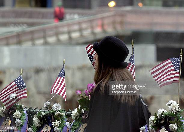 A woman looks out into what was the site of the World Trade Center after attending the 10th anniversary memorial service commemorating the 1993 World...