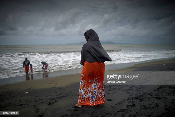 A woman looks out to the sea on the North Coast of Banda Aceh where 10 years ago a series of deadly tsunamis struck the province The tsunami of...