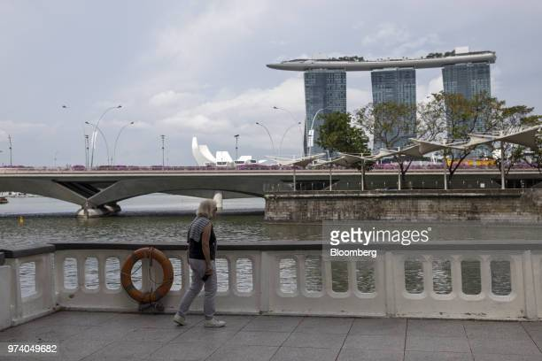 A woman looks out towards the Marina Bay Sands hotel and casino in Singapore on Wednesday June 13 2018 Tourism as well as the consumer sector will...