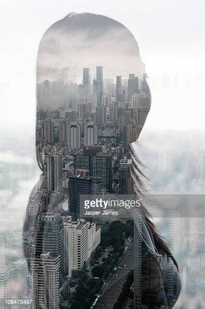 Woman looks over city