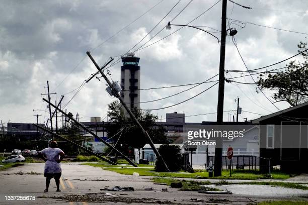 Woman looks over damage to a neighborhood caused by Hurricane Ida on August 30, 2021 in Kenner, Louisiana. Ida made landfall yesterday as a category...