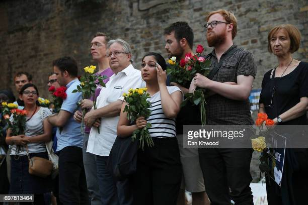A woman looks tearful as she attends a vigil outside Finsbury Park Mosque on June 19 2017 in London England Worshippers were struck by a hired van as...