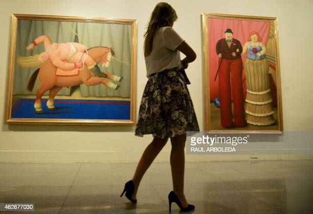 A woman looks the exhibition called The Circus by Colombian artist Fernando Botero at the Antioquia museum in Medellin Antioquia department Colombia...