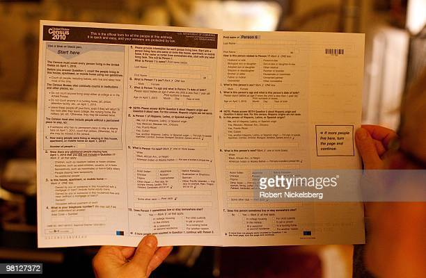 A woman looks through a 2010 census form March 18 2010 in Brooklyn New York The Census Bureau mailed a questionnaire to134 million US households with...