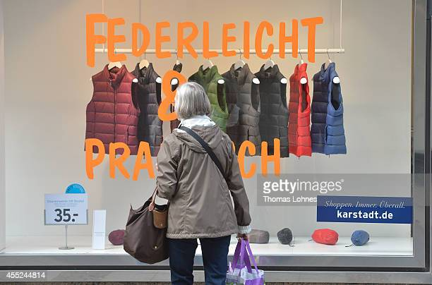 A woman looks to a shop window at Karstadt chain store on September 11 2014 in Darmstadt Germany Rene Benko head of Signa Holding and the biggest...