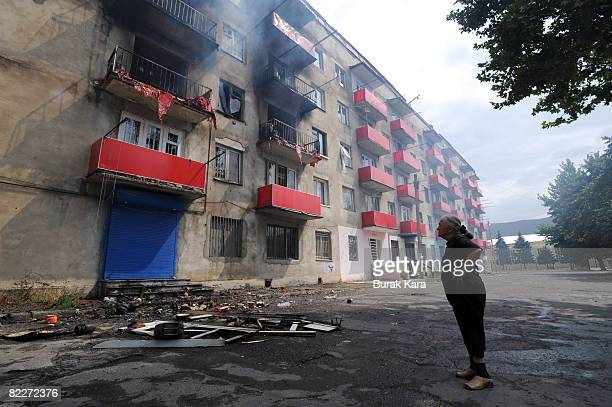 A woman looks to her house after her it was hit by a Russian shell on August 12 2008 in Gori Georgia Russian President Dmitry Medvedev has ordered an...