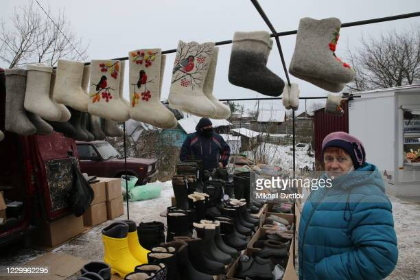 Woman looks to the felt boots at a street market, on December 5, 2020 in Staritsa, located on the Volga river, 250 kilometers northwest from Moscow,...