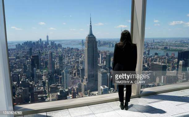 Woman looks towards lower Manhattan, with the Empire State Building , during a press preview of Summit One Vanderbilt on May 11 in New York. - Summit...