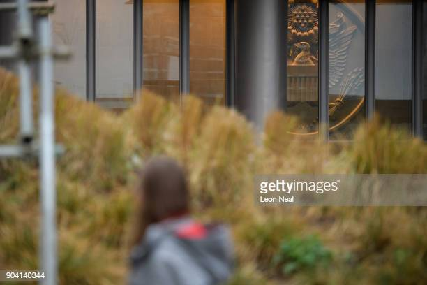 A woman looks towards the Great Seal of the United States within the new US embassy on January 12 2018 in London England President Trump has tweeted...