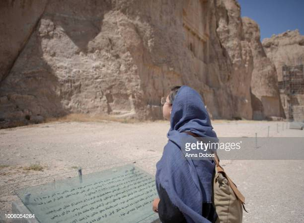 woman looks up at necropolis ruins - ancient civilization stock photos and pictures