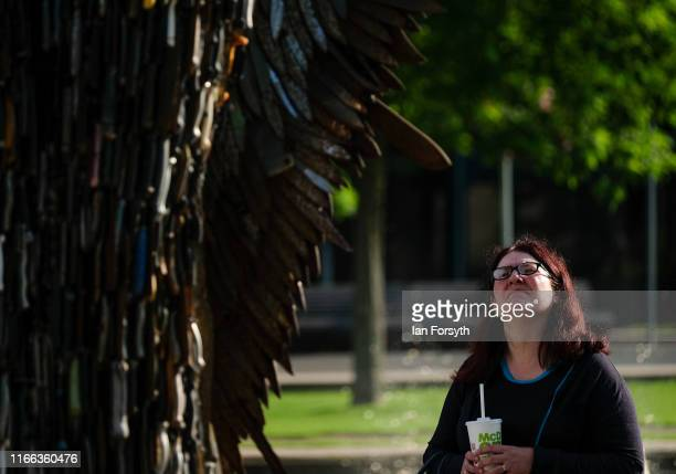 A woman looks up at the Knife Angel sculpture installed in the Centre Square in Middlesbrough on August 06 2019 in Middlesbrough England The 27ft...
