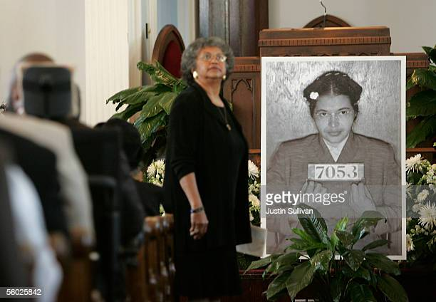 A woman looks up during a memorial service for civil rights icon Rosa Parks October 28 2005 in Montgomery Alabama Rosa Parks who died Monday at the...