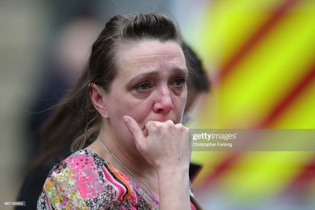 A woman looks upset after police avacuated the Arndale Centre on May 23, 2017 in Manchester, England. An explosion occurred at Manchester Arena as concert goers were leaving the venue after Ariana Grande had performed. Greater Manchester Police are treating the explosion as a terrorist attack and have confirmed 22 fatalities and 59 injured.