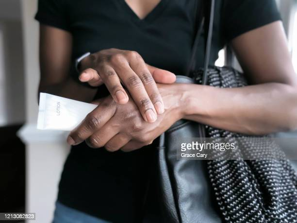 woman lotions hands - applying stock pictures, royalty-free photos & images