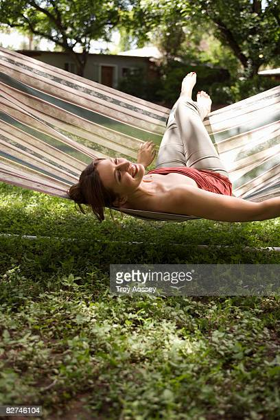 woman lounging on hammock smiling
