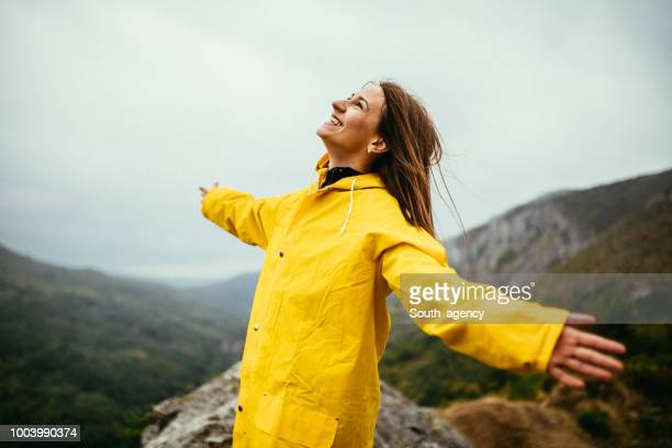 woman loves the rain - rainy season stock pictures, royalty-free photos & images