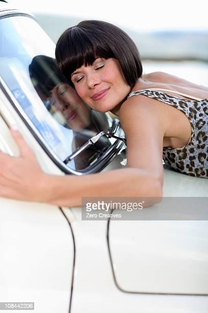 Woman loving her car