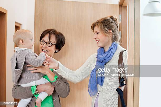 Woman loving her daughter at home arrival