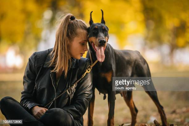Woman loving her doberman
