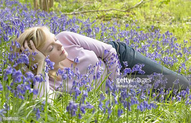 woman lying amongst bluebells, eyes closed - richard drury stock pictures, royalty-free photos & images