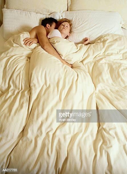 Woman Lying Awake Beside Her Sleeping Husband