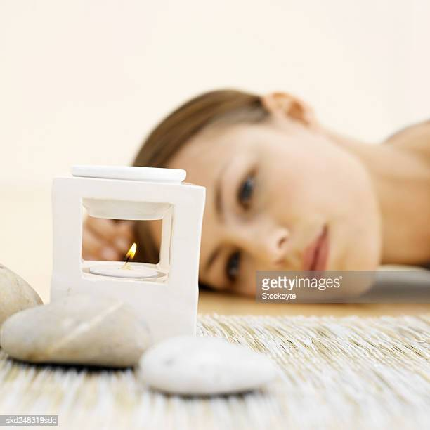 Woman lying beside an incense burner