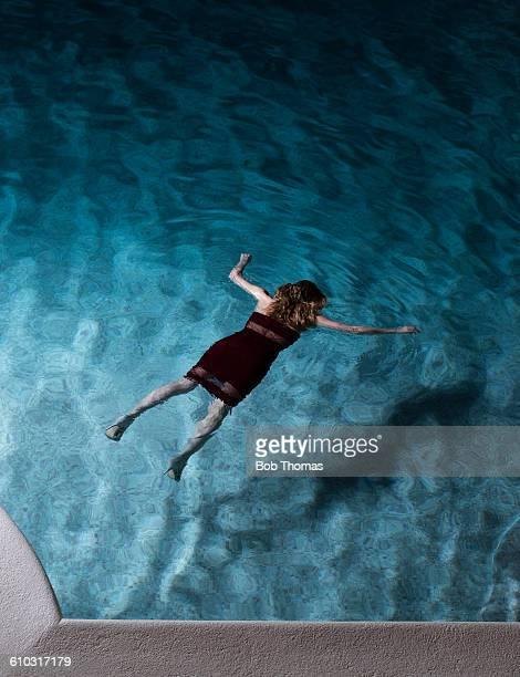 Woman Lying Dead in a Swimming Pool