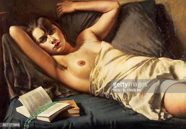 Woman lying down by Leonardo Dudreville Italy 20th century