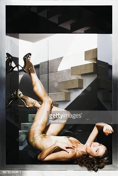 Woman lying down near stairway