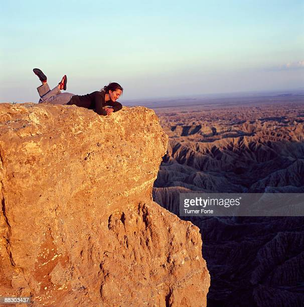 Woman lying down on rock, Carrizo Badlands, Anza-Borrego Desert State Park, Borrego Springs, California