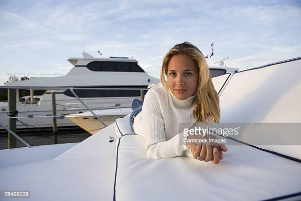 Woman lying down on yacht