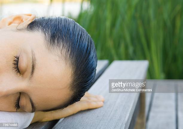 Woman lying down, outdoors