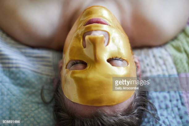 Woman lying down with a face mask on