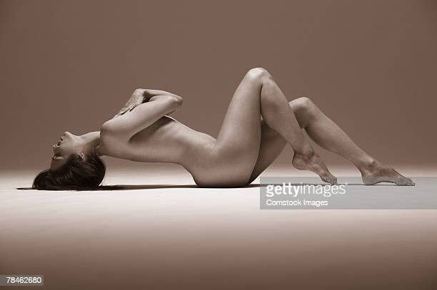 Woman lying down with back arched