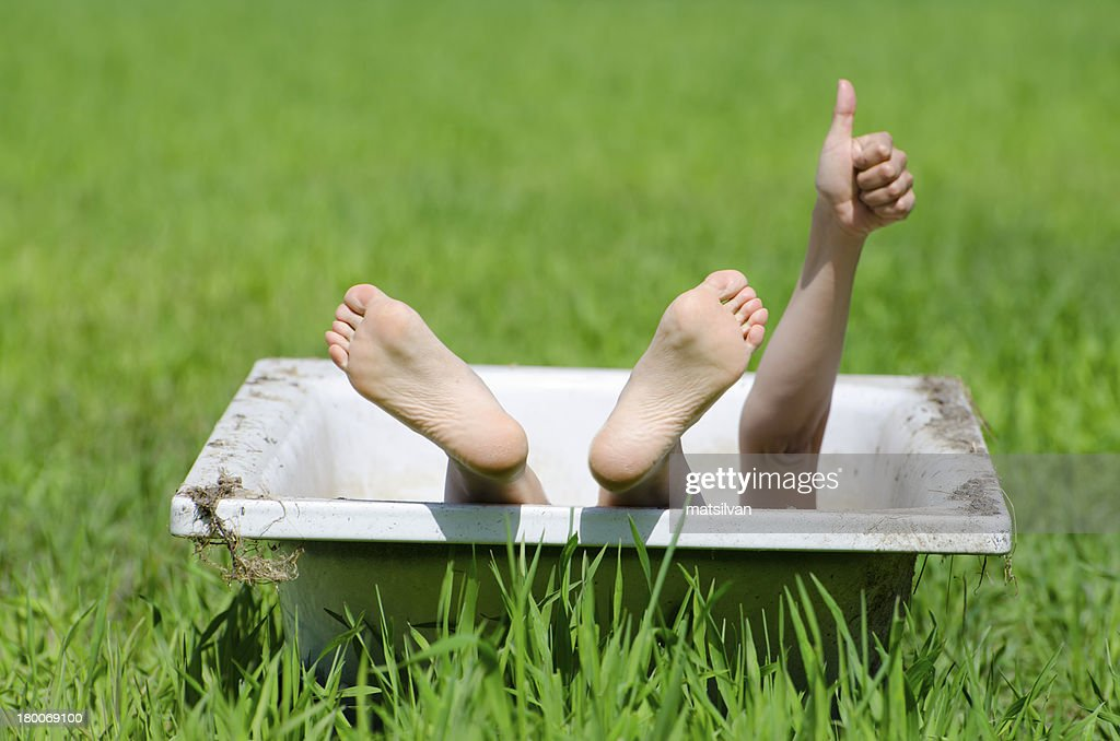 Woman Lying In A Bathtub Stock Photo   Getty Images