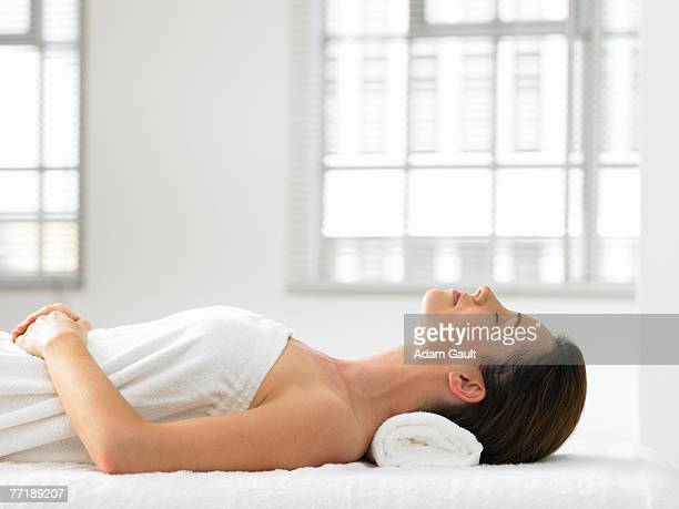 A woman lying in a spa