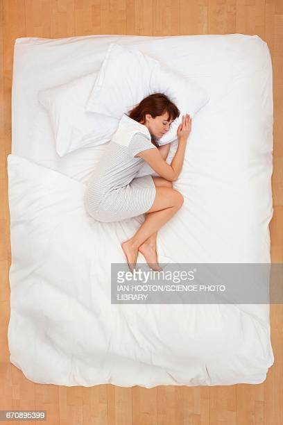 Woman lying in bed, asleep