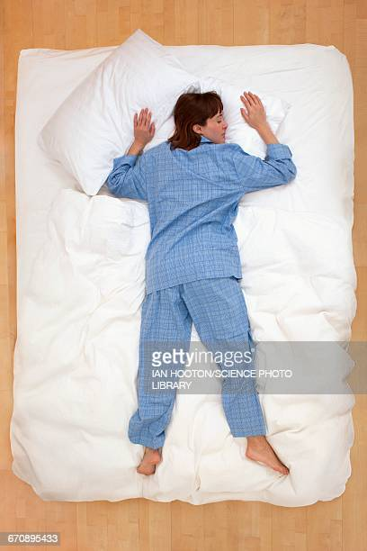 Woman lying in bed, asleep
